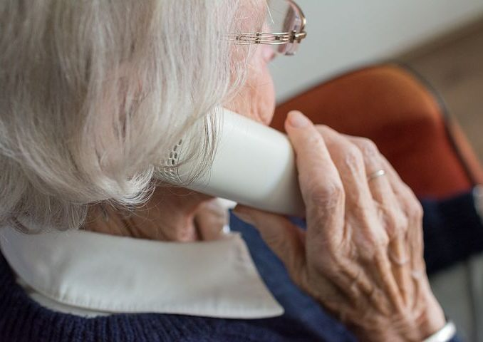 old woman talking to someone over the phone