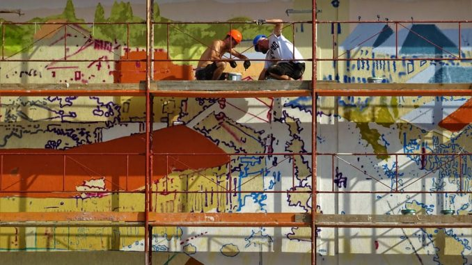 two men working on a scaffolding